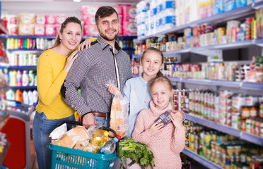 parents with girls with purchases during family shopping