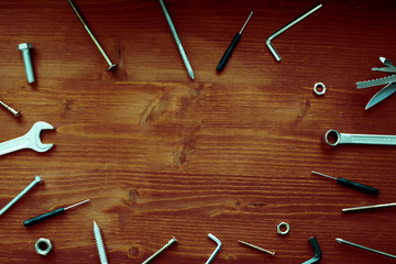 Industrial tools on bright brown wooden background with copy space. Top view horizontal tools background. Fathers day composition.