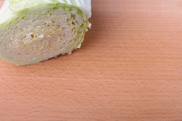 Fresh ripe Chinese cabbage and knife on the cutting board. Ingredients for salad. Ready for cooking. Close-up.
