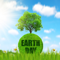 Green planet with tree in grass. Concept of Earth Day.