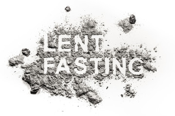 Lent fasting word written in ash, sand or dust