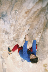 Rock-climbing in Turkey. The guy climbs on the route. Photo from the top.