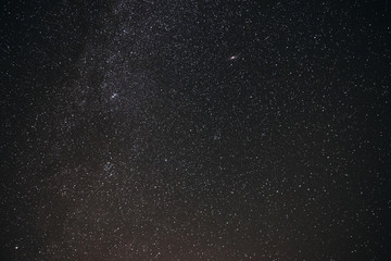 Background of gray starry night sky with the Milky Way
