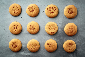 set of round cookies with different emotions, faces with emotions