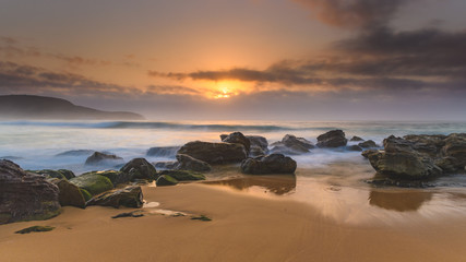 Hazy Sunrise Seascape with Rocks