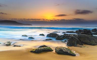 Hazy Sunrise Seascape with Rocks