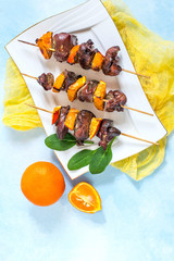 Shish kebabs from chicken liver with tangerines