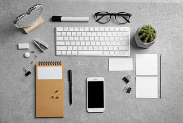 Set of devices and stationery on grey background. Mockup for design