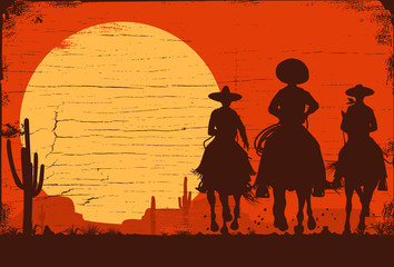 Silhouette of three Mexican cowboys riding horses on a wooden board