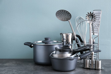 Foto op Canvas Koken Metal cooking utensils on table