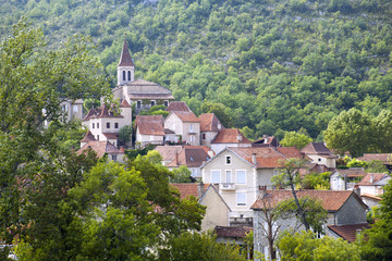 Village houses surround the church in Cabrerets, Lot, France, Europe