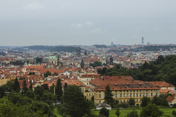 View of the Old Town of Prague from a high point. Red roofs, historical architecture. Czech Republic