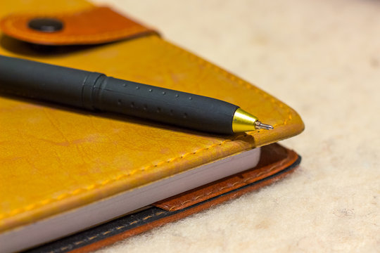 notebook and pen for recording information during  meeting at the office of company_