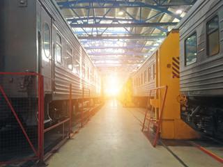 Passenger cars wagoon locomotive on repair in depots of railways, hangar view.