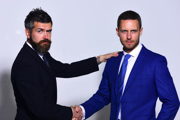 Business relationship concept. Businessmen with serious faces in formal wear