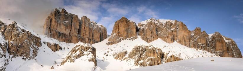 Panoramic landscape of the Sass Pordoi group in the Italian dolomites, as seen from Pass Pordoi. Canazei, Trento. Italy.