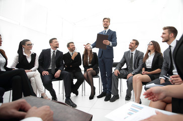 business coach communicate with the business team