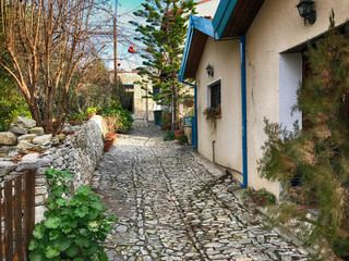 old houses and cobblestone street in picturesque village Laneia (Lania), Cyprus
