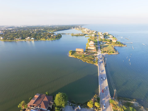 Aerial view of Seabrook city near Texas Gulf Coast and Clear Lake. Waterfront harbor town with pier. Wooden vacation house under construction. Real estate and beach travel background
