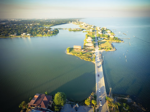 Aerial view of Seabrook city near Texas Gulf Coast and Clear Lake. Waterfront harbor town with bridge connected. Wooden vacation house under construction. Real estate, beach travel background. Vintage