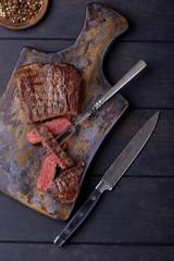 Slice steak on fork for meat