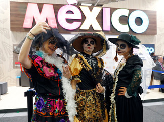 Exhibitors pose at the Mexico booth at the International Tourism Trade Fair ITB in Berlin, Germany