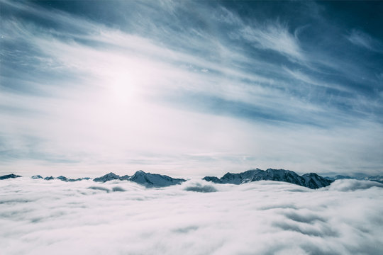 beautiful snow-covered mountain peaks and clouds, mayrhofen, austria