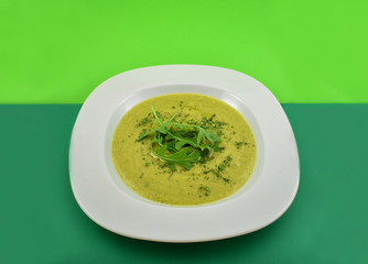 Vegetable Soup stock images. Green soup on a green background. Healthy snack images