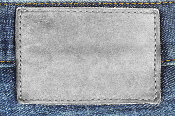 Empty leather jeans label background isolated on white background.