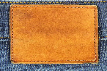 Blue Jeans empty leather label as background.