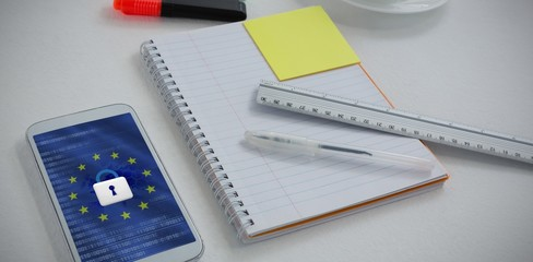Composite image of mobile phone and stationery on white