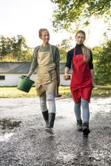Two women working on a farm