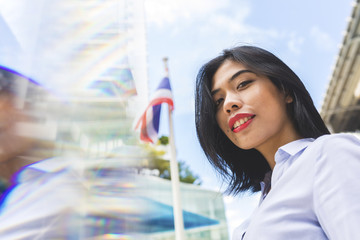 Thailand, Bangkok, portrait of smiling businesswoman in the city