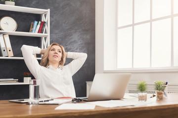 Businesswoman relaxing during office break