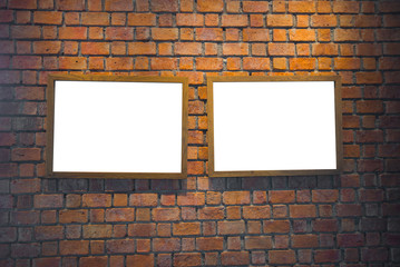 Empty frames on brown brick wall