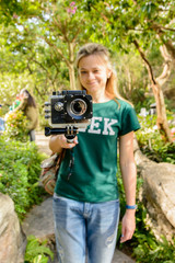 Girl photographer shoots video and photo on action camera