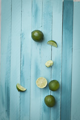 fresh lemons on a turquoise wooden background