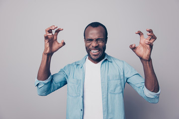 Portrait of nervous, angry, violent, out of himself, emotional man gesture with hands, looking at camera, isolated on grey background, tired from routine