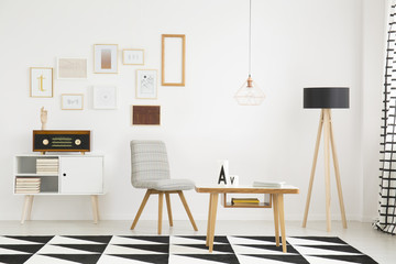 Wooden lamp and gray chair