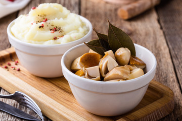 Homemade pickled mushrooms and mashed potatoes