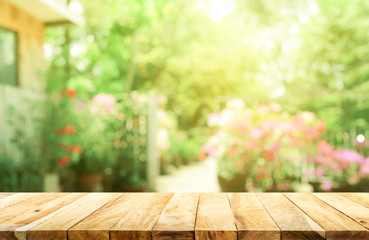 Empty wood table top on blur abstract green from garden and house background Wall mural