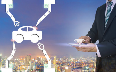 Industry 4.0 manufacture car using a robot of men hold a smartphone.