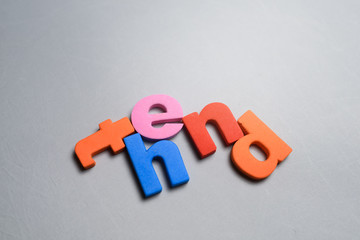 The end, word written on white background with colorful polystyrene letters.