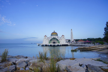 Majestic view of Malacca Straits Mosque during blue hour.