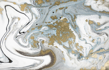 Marble abstract acrylic background. Nature marbling artwork texture. Golden glitter.