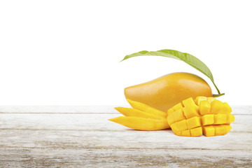Mango fruit on white table and empty space for text, isolated background