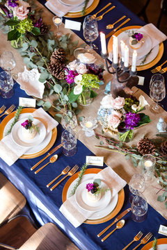 Navy Blue and Gold Themed Wedding Table with Natural Center Pieces
