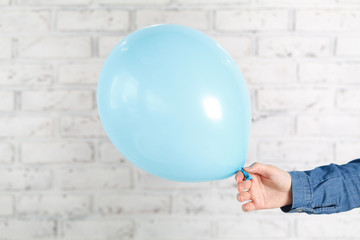 Blue balloon in female hands