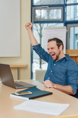 Jubilant businessman cheering a success