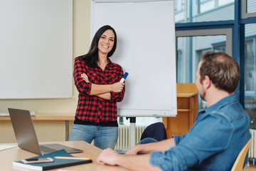 Relaxed confident young woman doing a presentation